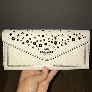 Handbags - Coach- studded envelope wallet